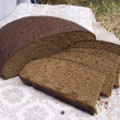 Fresh homemade black round rye bread — Stock Photo