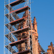 图库照片: Church tower renovation against blue sky