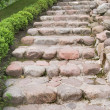Stock Photo: Natural stone steps along a hedgerow