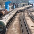 The train transports oil in tanks - Stock Photo