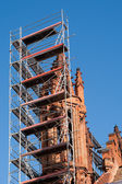 Church tower renovation against a blue sky — Stock Photo