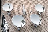 Five satellite antennas — Stock Photo