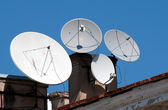 Four satellite dish antennas — Stock Photo