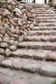 Stairs along a stone wall — Stock Photo