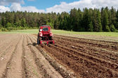 Tractor at work on a field — Stock Photo