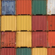 Colorful ship cargo containers stacked up in a port. — Foto de Stock