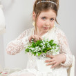 A beautiful little girl with flowers in a pot — Stock Photo