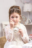 A beautiful little girl having a tea party — Stock Photo