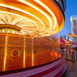 Merry-go-round in motion - Stock Photo