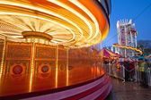 Merry-go-round in motion — Stock Photo