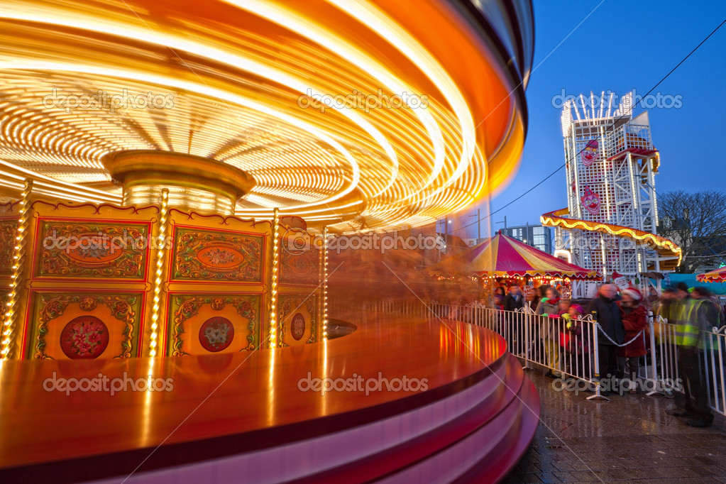 Merry-go-round in motion at Christmas market in Galway, Ireland — Stock Photo #8198390