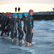 Stock Photo: Swimmers prepare to start