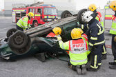 Fire and Rescue service staff at car crash training — Stock Photo