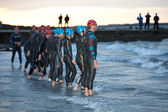 Swimmers prepare to start — Stock Photo
