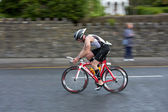 Cyclist, Fergal O Dowd (1134), panning technique — Stock Photo