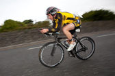 Cyclist, panning technique, 2nd Curtain Sync Flash — Stock Photo