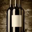 Bottles of red wine, sepia — Stock Photo