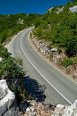 A scenic and winding road between mountains, leading to the top — Stock Photo