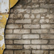 Weathered stained old brick wall — Foto de stock #8612354