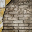 Weathered stained old brick wall — Stock Photo