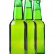 Stock Photo: Three green bottles of beer isolated on white