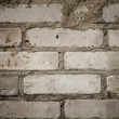 Weathered stained old brick wall — Stockfoto #8612389