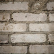 Stockfoto: Weathered stained old brick wall