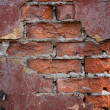 Photo: Weathered stained old brick wall