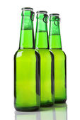Three green bottles of beer isolated on white — Stock Photo