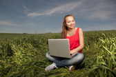Young Woman in the field — Stockfoto