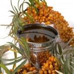 Oil of sea-buckthorn berries. — Stock Photo