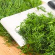 Dill on kitchen board — Stock Photo #9186476