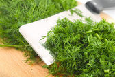 Dill on kitchen board — Stock Photo