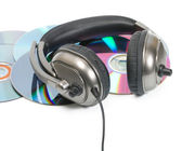 Headphone in CD stack — Stock Photo