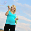 Pregnant woman with soap bubbles — Stock Photo #9062203