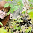 Redheaded girl in forest — Stock Photo