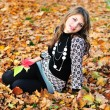 In falling leaves — Stock Photo