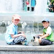 Stock Photo: Boys near waterworks