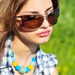 Portrait of girl wearing sunglasses — Stock Photo