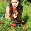 Girl on meadow with poppy — Stock Photo