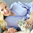 Happy pregnant woman with cat - Stock Photo