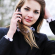 Teen girl with mobile phone - Stock Photo