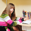 Stock Photo: Writing teen girl