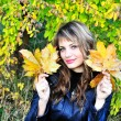Happy girl with leaves — Stock fotografie