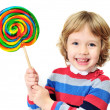 Laughing girl with candy — Stock Photo #9158442