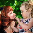 Mother and daughter playing in park — Stock Photo #9158505