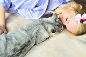 Girl with caressing cat — Stock Photo