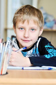 Homework of left-handed boy — Stock Photo