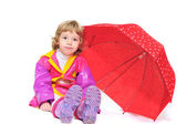 Girl with umbrella making face — Stock Photo