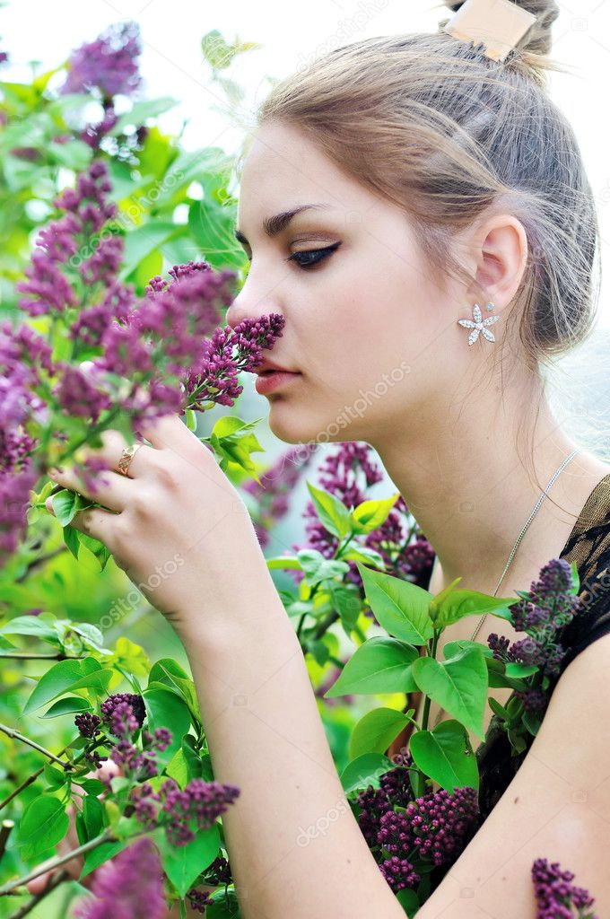 Tender young girl smelling lilac — Stock Photo #9158593